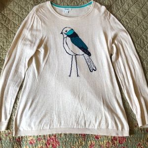 White sweater with cute blue bird design